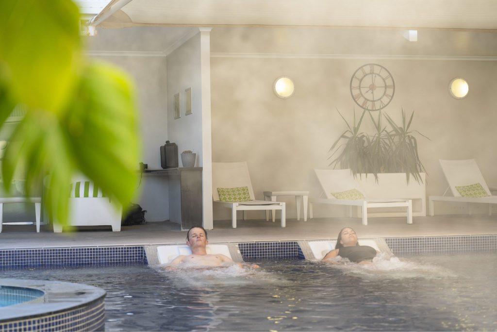 Couple relaxing in Artesian Pool