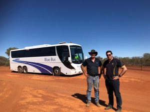 bus and two people in desert
